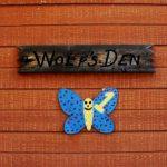 Wolf's Den Sign on Cabin